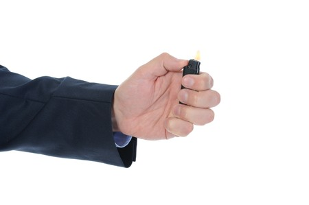burning cigarette lighter in male hand isolated on white background photo