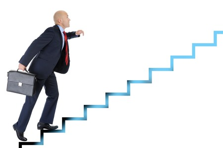 steps to success: Businessman with briefcase in hand, runs up the career ladder. Isolated on white background