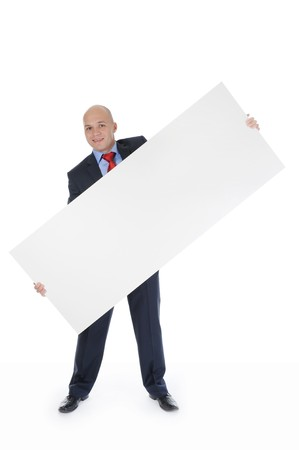 Young smiling businessman in black suit holding large blank. Isolated on white background Stock Photo - 7890929
