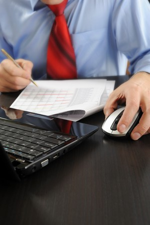 Image of a businessman working with documents in the office of the table Stock Photo - 7905848