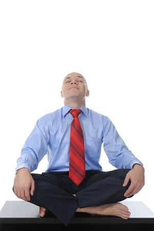 businessman meditating in yoga lotus. Isolated on white background Stock Photo - 7890972