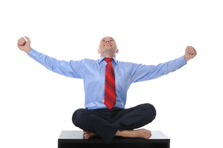 businessman meditating in yoga lotus. Isolated on white background Stock Photo - 7890939