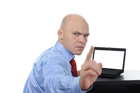 Frustrated man in front of laptop. Isolated on white background photo