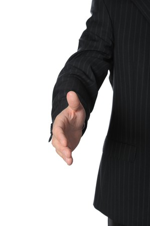 Businessman holds out his hand for a handshake. Isolated on white background  photo