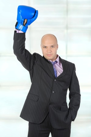 Businessman with boxing gloves raised his hand. photo