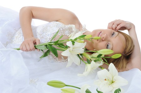 young bride with a bouquet of lilies Isolated on white background