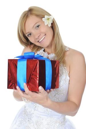 Bride hugging gift box. Isolated on white background photo