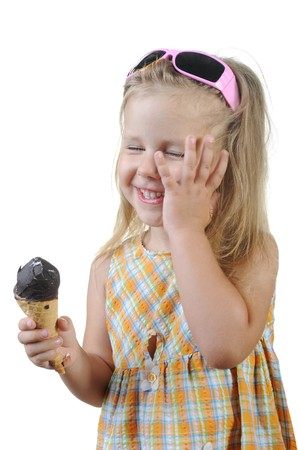 child eating ice cream. Isolated on a white background Stock Photo - 7891025