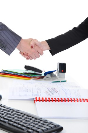 Handshake men and women, when signing documents. Isolated on white background Stock Photo - 7905845