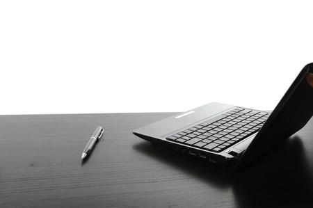 Open black laptop computer. Isolated on white background photo