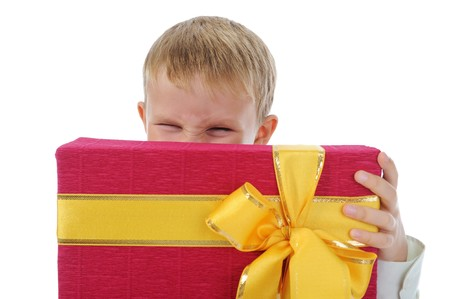 boy holding gift box . Isolated on white background photo
