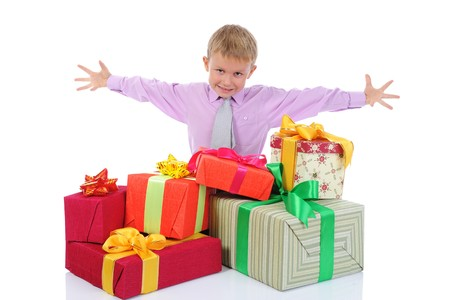 boy with a bunch of gifts . Isolated on white background photo