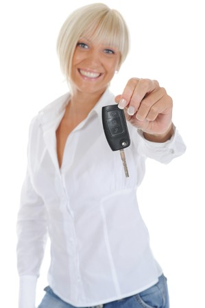 woman holds the key to the car. Isolated on white background photo