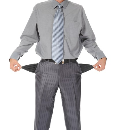 Businessman with empty pockets. Isolated on white background Stock Photo - 7983418