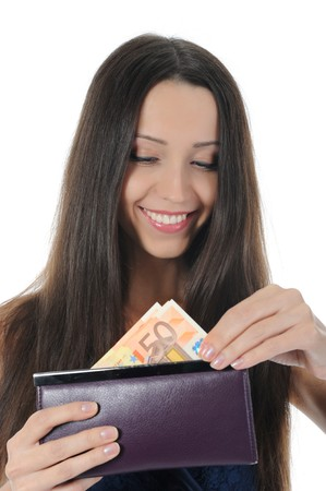 Long-haired brunette pulls from her purse euro banknotes. Isolated on white background photo