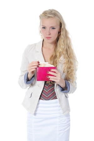 Long-haired blonde pulls from her purse euro banknotes. Isolated on white Stock Photo - 7983456