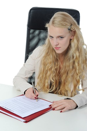 Long-haired blonde in the office signed a contract. Isolated on white photo