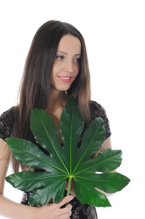Long-haired  brunette with green leaf. Isolated on white photo