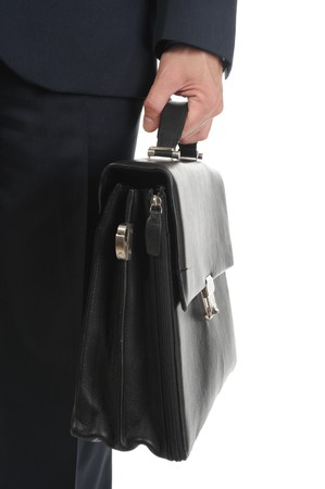 Image of a businessman holding a briefcase. Isolated on white background photo