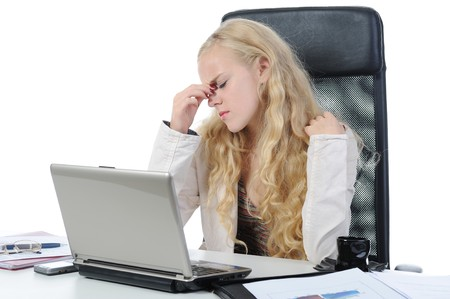 tired young blonde woman in the office at the workplace suffers headaches. Isolated on white Stock Photo - 7983535