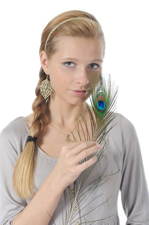 Portrait of the young woman with with a peacock feather. Isolated on white background photo