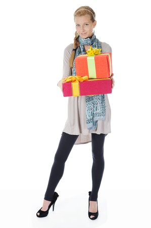 Young blonde woman in a full-length with a gift box. Isolated on white background photo