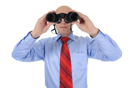 Image of a bald businessman looking through binoculars. Isolated on white background photo