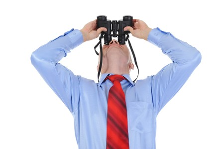 Image of a bald businessman looking up through binoculars. Isolated on white background Stock Photo - 7983522