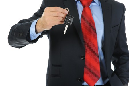 lucky man: Image of a businessman gives the keys to the car. Isolated on white