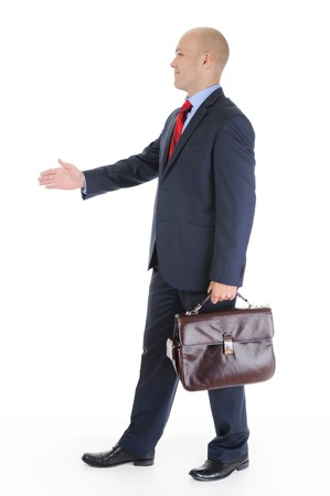 Businessman in full-length stretches out his hand for a handshake. Isolated on white background photo