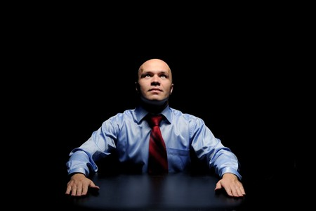 Portrait of young businessman in a dark room Stock Photo - 7983470