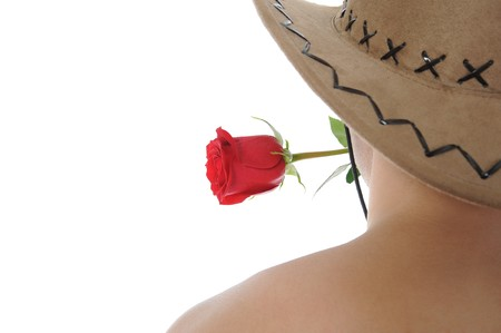 man in a hat holding a red rose in her teeth. Isolated on white background photo