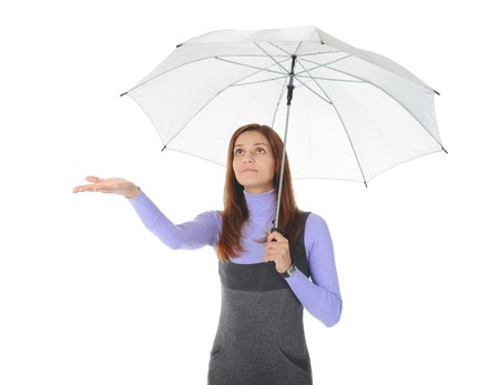 Image of a girl with umbrella. Isolated on white background photo