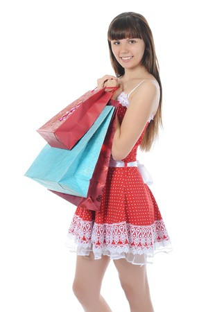 beautiful girl with shopping bags. Isolated on white background photo