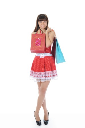 beautiful woman in a full-length with shopping bags. Isolated on white background photo
