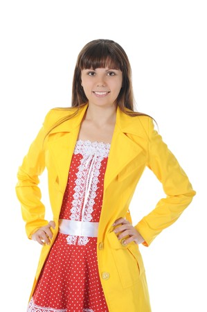 beautiful smiling girl in  in a yellow raincoat.  Isolated on white background Stock Photo - 7983508