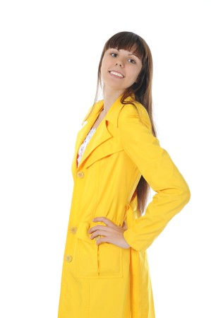 beautiful smiling woman in  in a yellow raincoat.  Isolated on white background photo