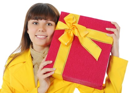 Long-haired brunette with a gift. Isolated on white background photo