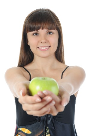 Athletic girl holding a green apple in hand. Isolated on white background Stock Photo - 7983500