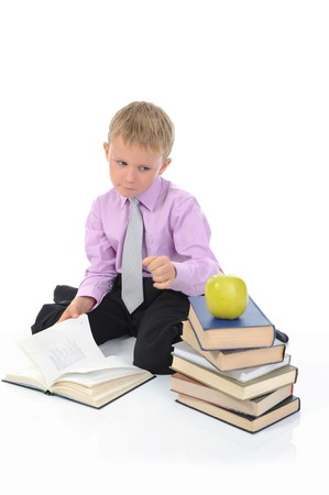 Little boy reading a book. Isolated on white Stock Photo - 7983485