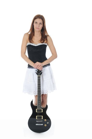 beautiful woman in a full-length with a black guitar in his hand. Isolated on white background photo