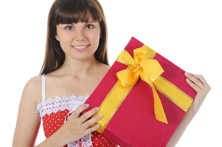 Long-haired brunette in red with a gift. Isolated on white background photo