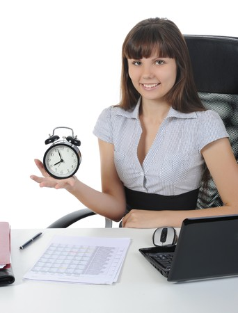 happy business woman with alarm in his hand in the office. Isolated on white background photo