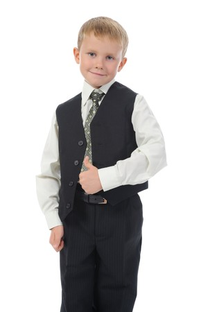 Blond little boy in school suit. Isolated on white background photo