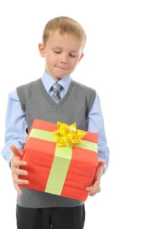Joyful boy holding present box . Isolated on white background Stock Photo - 7983571