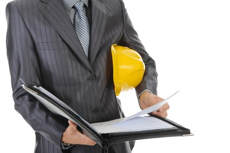 Businessman with construction helmet. Isolated on white background photo