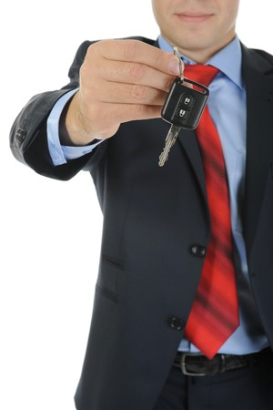 Image of a businessman gives the keys to the car. Isolated on white Stock Photo - 7983606