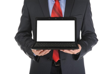 Businessman holding an open laptop. Isolated on white background photo