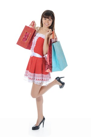 beautiful woman in a full-length with shopping bags. Isolated on white background Stock Photo - 7983605