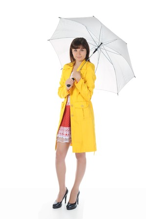beautiful smiling girl in  in a yellow raincoat with umbrella.  Isolated on white background Stock Photo - 7983592